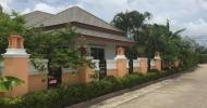 Hus m/tropisk hage til salgs